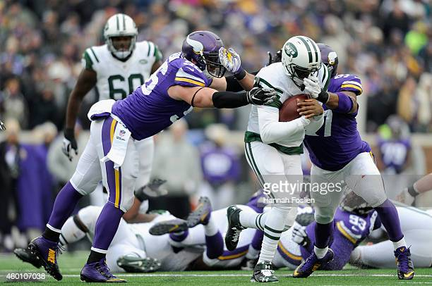 Brian Robison and Everson Griffen of the Minnesota Vikings tackle Geno Smith of the New York Jets during the second quarter of the game on December...