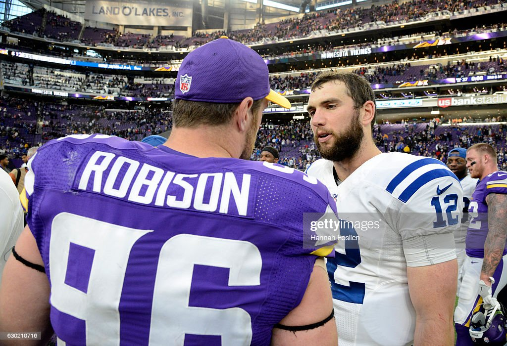 Brian Robison #96 of the Minnesota Vikings and Andrew Luck #12 of the Indianapolis Colts greet each other after the game on December 18, 2016 at US Bank Stadium in Minneapolis, Minnesota. The Colts defeated the Vikings 34-6.