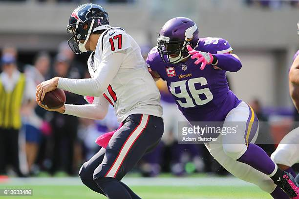Brian Robison of the Minnesota Vikings attempts to tackle Brock Osweiler of the Houston Texans during the fourth quarter of the game on October 9,...
