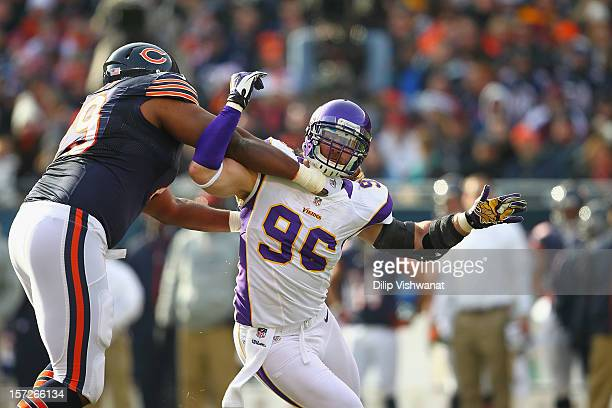 Brian Robison of the Minnesota Vikings blocks against the Chicago Bears at Soldier Field on November 25, 2012 in Chicago, Illinois.
