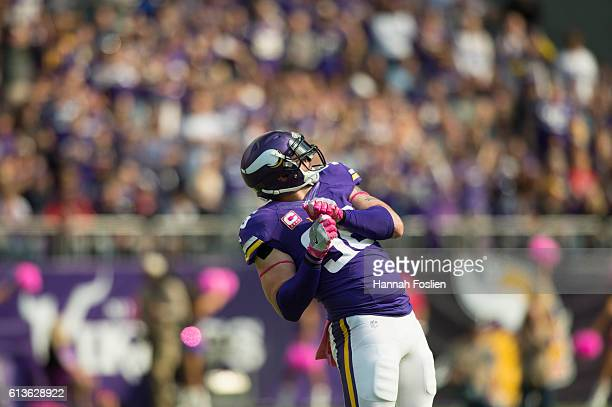 Brian Robison of the Minnesota Vikings celebrates after sacking quarterback Brock Osweiler of the Houston Texans during the third quarter of the game...