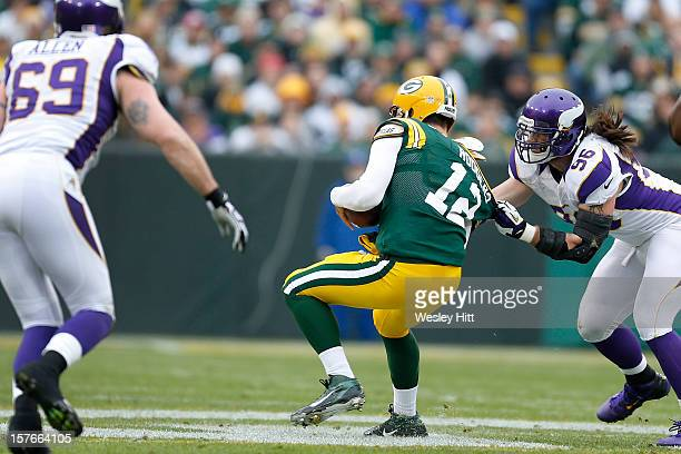 Brian Robison of the Minnesota Vikings grabs Aaron Rodgers of the Green Bay Packers at Lambeau Field on December 2, 2012 in Green Bay, Wisconsin. The...