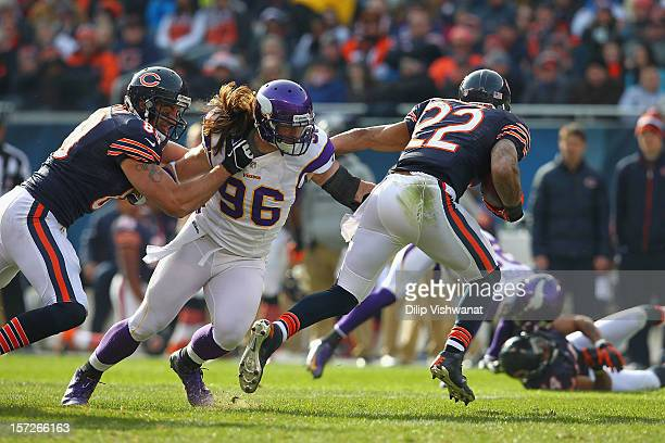 Brian Robison of the Minnesota Vikings makes a tackle against the Chicago Bears at Soldier Field on November 25, 2012 in Chicago, Illinois.