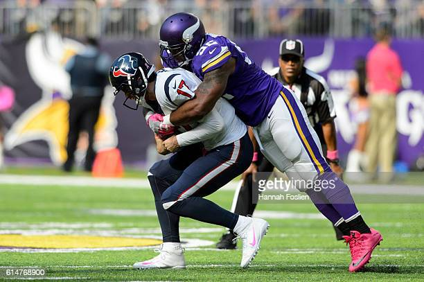 Brian Robison of the Minnesota Vikings sacks Brock Osweiler of the Houston Texans during the game on October 9, 2016 at US Bank Stadium in...