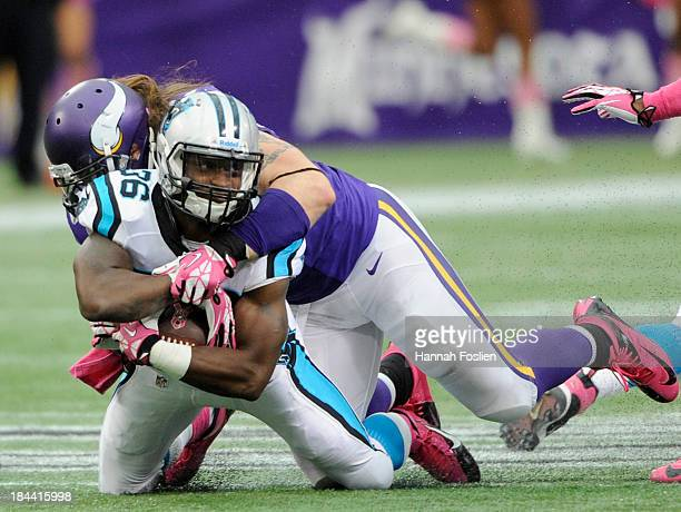 Brian Robison of the Minnesota Vikings tackles Armond Smith of the Carolina Panthers during the fourth quarter of the game on October 13, 2013 at...