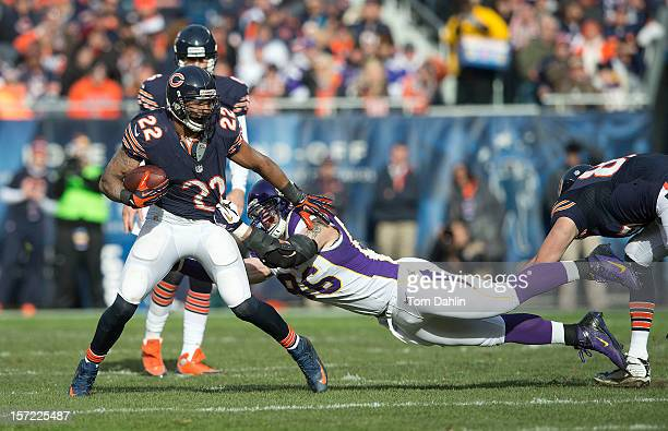 Brian Robison of the Minnesota Vikings tackles Matt Forte of the Chicago Bears during an NFL game against the Chicago Bears at Soldier Field on...