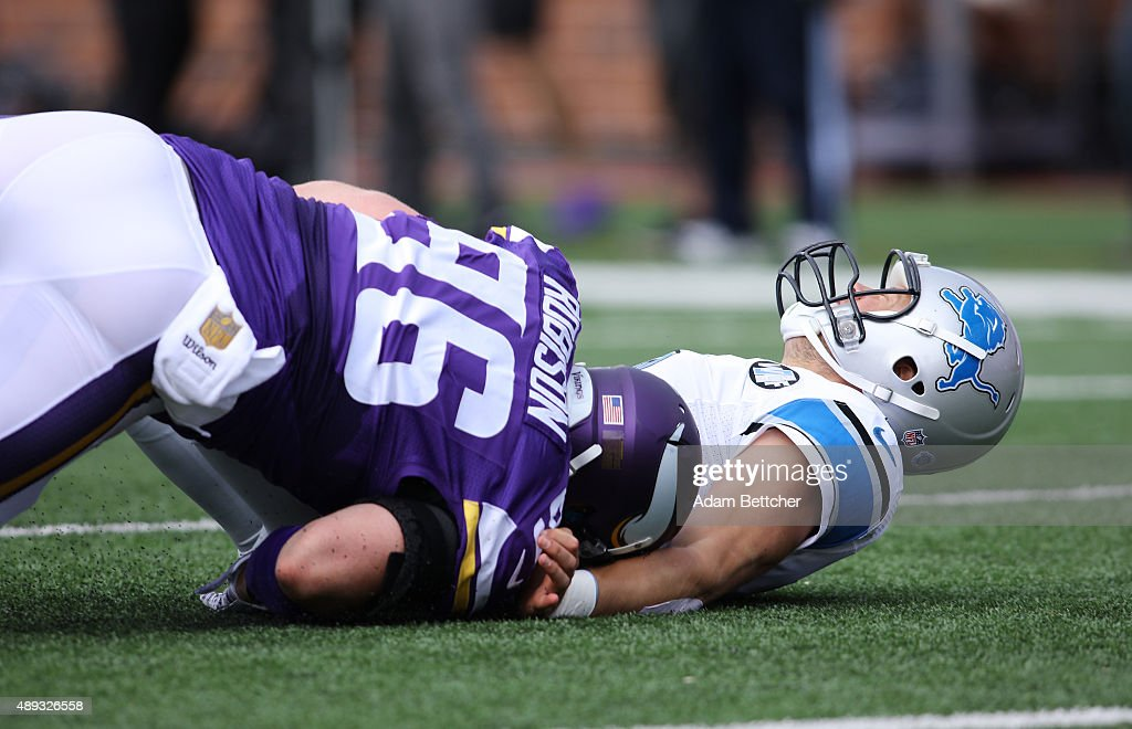 Brian Robison #96 of the Minnesota Vikings tackles Matthew Stafford #9 of the Detroit Lions in the first quarter at TCF Bank Stadium on September 20, 2015 in Minneapolis, Minnesota.