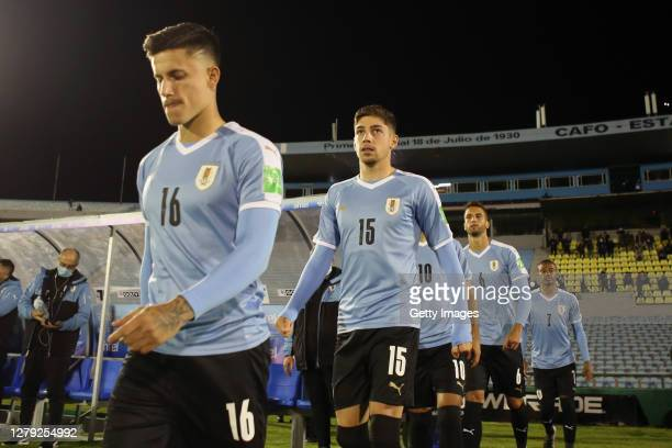 Brian Rodríguez and Federico Valverde of Uruguay enter the pitch prior to a match between Uruguay and Chile as part of South American Qualifiers for...