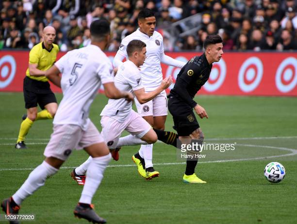 Brian Rodriguez of Los Angeles FC dribbles in front of Victor Ulloa Wil Trapp and Nicolas Figal of Inter Miami CF during a 10 Los Angeles FC win at...