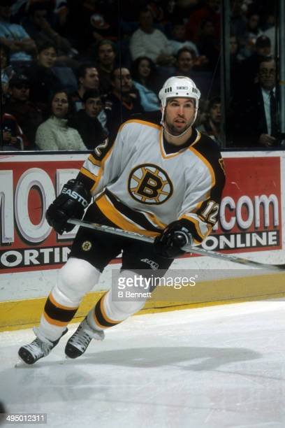 Brian Rolston of the Boston Bruins skates on the ice during an NHL game against the New York Islanders on December 22 2001 at the Nassau Coliseum in...