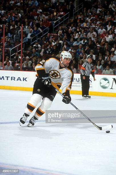 Brian Rolston of the Boston Bruins skates with the puck during an NHL game against the Philadelphia Flyers on October 7, 2000 at the Wells Fargo...