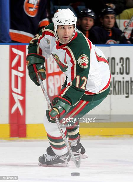 Brian Rolston of the Minnesota Wild controls the puck against the New York Islanders during their game on December 13, 2005 at Nassau Coliseum in...