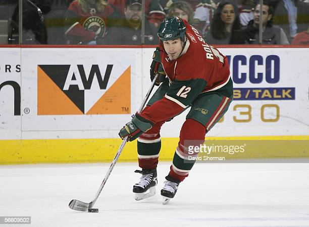 Brian Rolston of the Minnesota Wild skates with the puck against the Vancouver Canucks during the NHL game on December 31 2005 at the Xcel Energy...