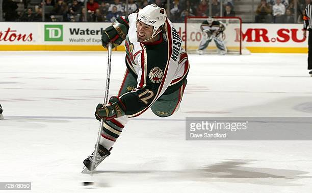 Brian Rolston of the Minnesota Wild takes a shot against the Toronto Maple Leafs during their NHL game at the Air Canada Centre December 26 2006 in...