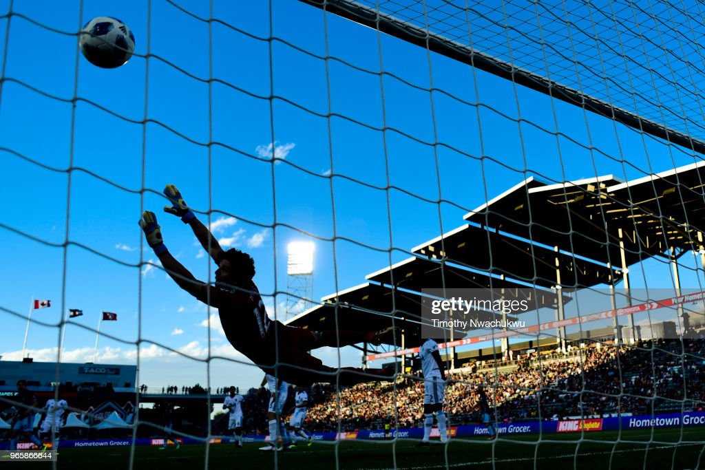 Brian Rowe #12 of Vancouver Whitecaps is unable to block a goal scored by Edgar Castillo #2 of Colorado Rapids at Dick's Sporting Goods Park on June 1, 2018 in Commerce City, Colorado.