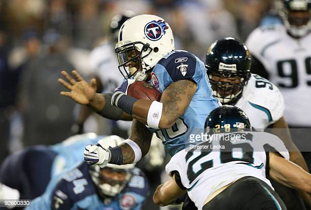 Brian Russell of the Jacksonville Jaguars tries to tackle LenDale White of the Tennessee Titans during their game at LP Field on November 1 2009 in...