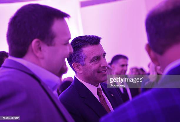 Brian Sandoval governor of Nevada center speaks to attendees during the Faraday Future Inc event at the 2016 Consumer Electronics Show in Las Vegas...