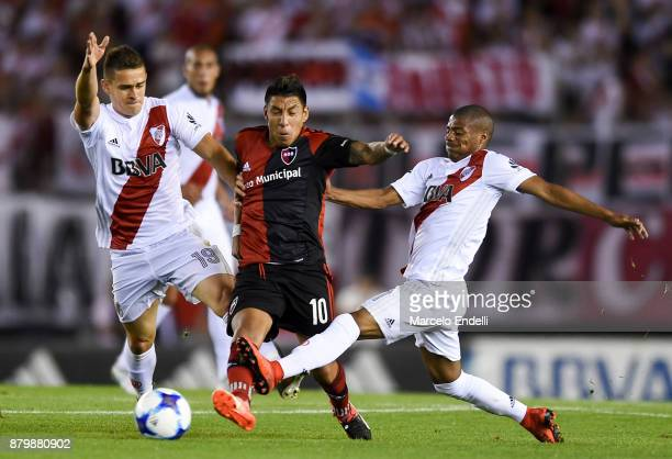 Brian Sarmiento of Newells Old Boys fights for ball with Nicolas De La Cruz and Rafael Santos Borre of River Plate during a match between River and...