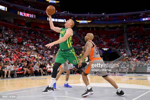 Brian Scalabrine of the Ball Hogs attempts a shot while being guarded by Dahntay Jones of 3's Company during BIG3 Week Four at Little Caesars Arena...