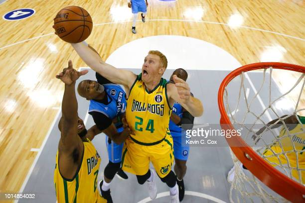 Brian Scalabrine of the Ball Hogs grabs a rebound against Cuttino Mobley of the Power during week eight of the BIG3 three on three basketball league...
