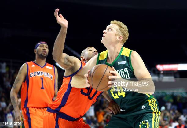 Brian Scalabrine of the Ball Hogs handles the ball against Dahntay Jones of 3's Company during week four of the BIG3 three on three basketball league...