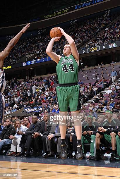 Brian Scalabrine of the Boston Celtics shoots against the New Jersey Nets on March 3 2007 at Continental Airlines Arena in East Rutherford New Jersey...