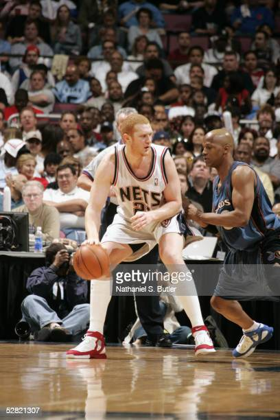 Brian Scalabrine of the New Jersey Nets is defended by Anthony Peeler of the Washington Wizards during the game on April 17 2005 at the Continental...