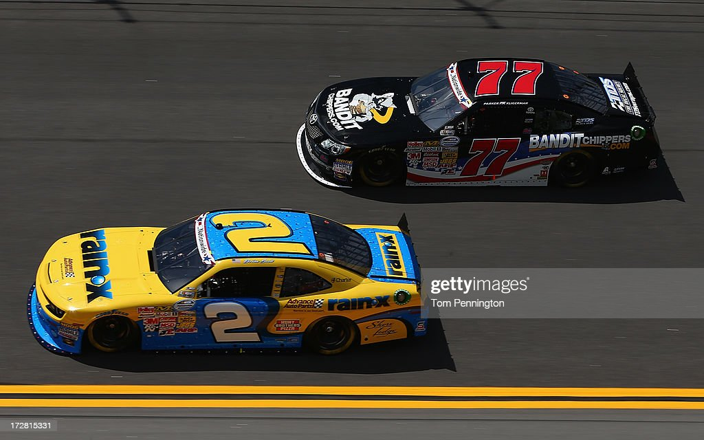 Brian Scott, driver of the #2 Rain-X / Advance Auto Parts Chevrolet, and Parker Kligerman, driver of the #77 BanditChippers.com Toyota, during practice for the NASCAR Nationwide Series Subway Firecracker 250 at Daytona International Speedway on July 4, 2013 in Daytona Beach, Florida.