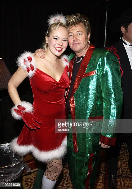 Brian Setzer and and his guest Julie backstage at TNT's Christmas in Washington Concert to air Sunday December 15 at 8pm ET/PT live from the National...