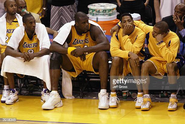 Brian Shaw Kobe Bryant Shaquille O'Neal Robert Horry and Derek Fisher of the Los Angeles Lakers sit on the bench during Game six of the Western...