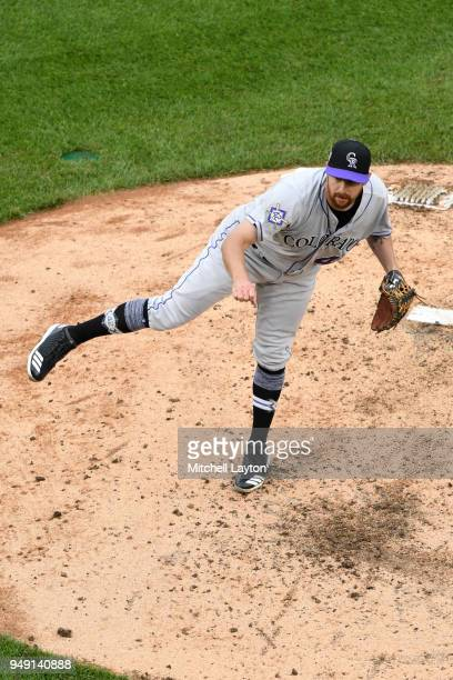 Brian Shaw of the Colorado Rockies pitches during a baseball game against the Washington Nationals at Nationals Park on April 15 2018 in Washington...