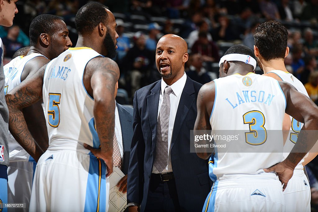 Brian Shaw of the Denver Nuggets coaches his team against the Phoenix Suns on October 23, 2013 at the Pepsi Center in Denver, Colorado.