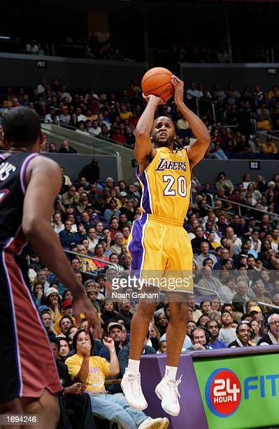 Brian Shaw of the Los Angeles Lakers shoots a jump shot during a game against the Utah Jazz at Staples Center on December 8 2002 in Los Angeles...