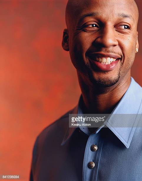 Brian Shaw Smiling in a Blue Shirt