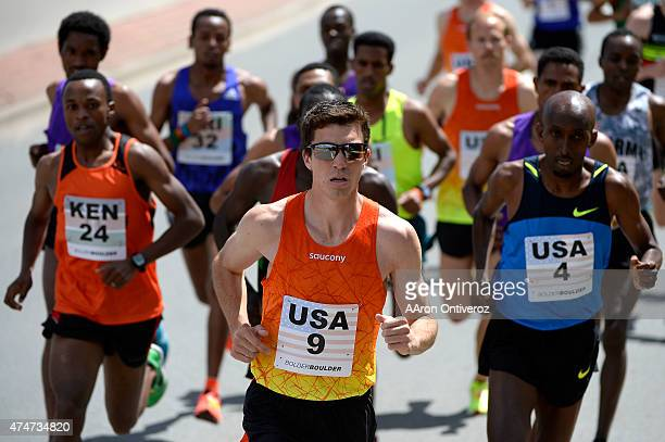 Brian Shrader of the USA briefly leads the pack as he is flanked by countryman Abdi Abdirahman and Kenya's Isaac Mukundi Mwangi during the Bolder...