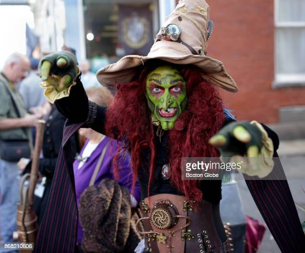 Brian Sims of the Salem Black Hat Society performs for crowd during the annual Halloween celebrations in Salem MA on Oct 28 2017