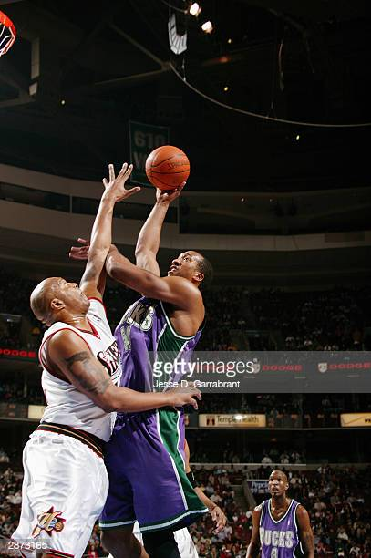 Brian Skinner of the Milwaukee Bucks shoots over Derrick Coleman of the Philadelphia 76ers during the game at Wachovia Center on January 5 2004 in...