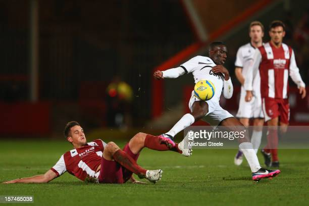 Brian Smikle of Hereford United hurdles a challenge from Darren Carter of Cheltenham Town during the FA Cup with Budweiser Second Round match between...