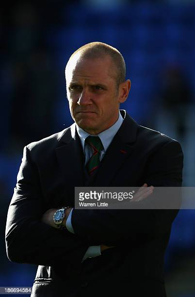 Brian Smith head coach of London Irish looks on ahead ofthe Aviva Premiership match between London Irish and Northampton Saints at Madejski Stadium...