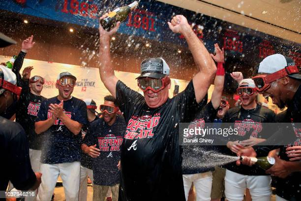 Brian Snitker of the Atlanta Braves celebrates with champagne after clinching the NL East Division against the Philadelphia Phillies at SunTrust Park...