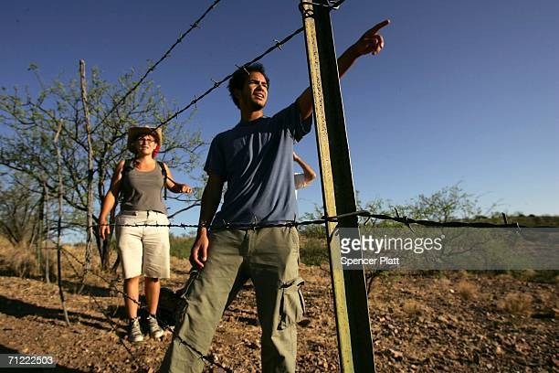 Brian Stanley and Katie Resendiz volunteers on patrol with the humanitarian group No More Deaths search for migrants in distress on a trail used by...