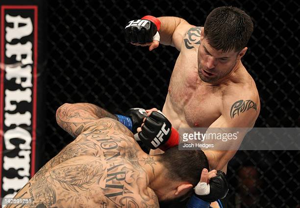 Brian Stann punches Alessio Sakara during their middleweight bout at the UFC on Fuel TV event at Ericsson Globe on April 14 2012 in Stockholm Sweden
