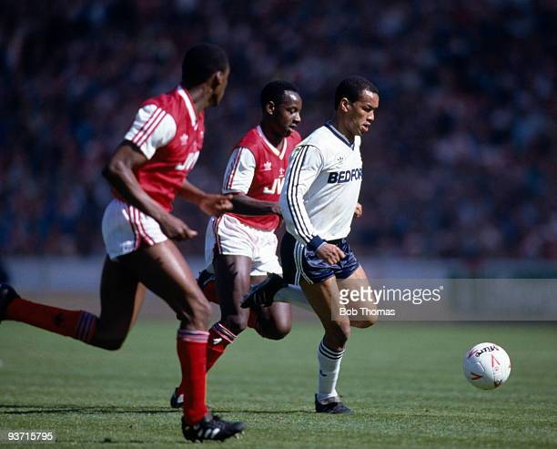 Brian Stein of Luton Town goes past Paul Davis and Michael Thomas of Arsenal during the Littlewoods Cup Final held at Wembley Stadium London on 24th...