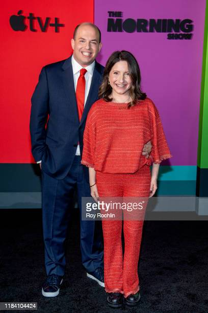 Brian Stelter and Jamie Shupak Stelter attend Apple TV's The Morning Show world premiere at David Geffen Hall on October 28 2019 in New York City