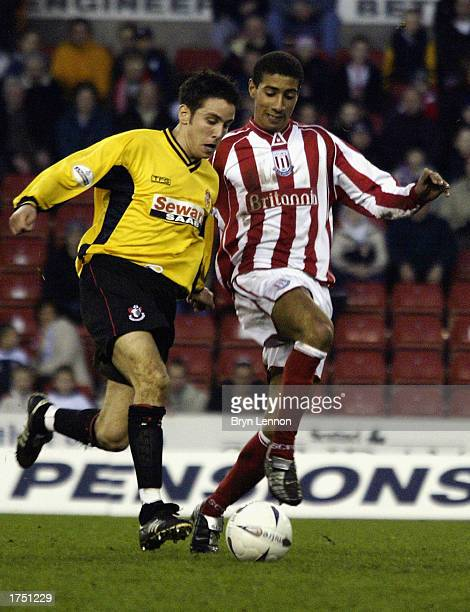 Brian Stock of Bournemouth tackles Wayne Thomas of Stoke City during the FA Cup fourth round match between Stoke City and AFC Bournemouth held on...