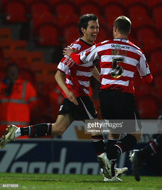 Brian Stock of Doncaster celebrates his goal with team mate Matt Mills during the FA Cup sponsored by Eon Third round Replay match betweeen Doncaster...