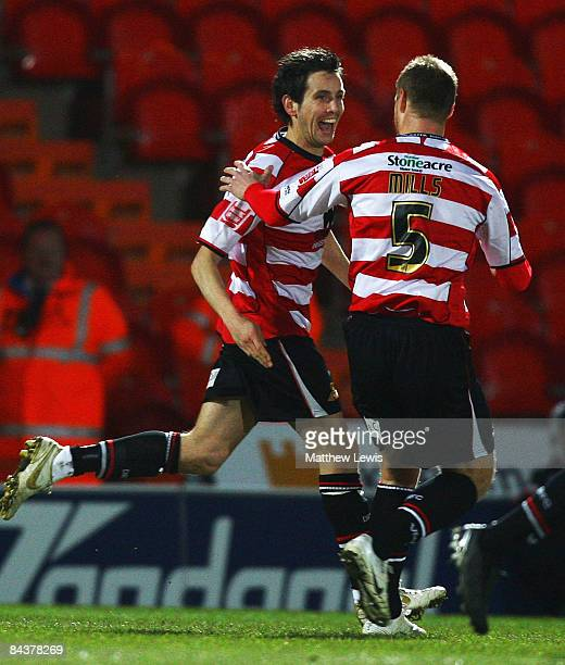 Brian Stock of Doncaster celebrates his goal with team mate Matt Mills during the FA Cup sponsored by Eon third round replay match between Doncaster...