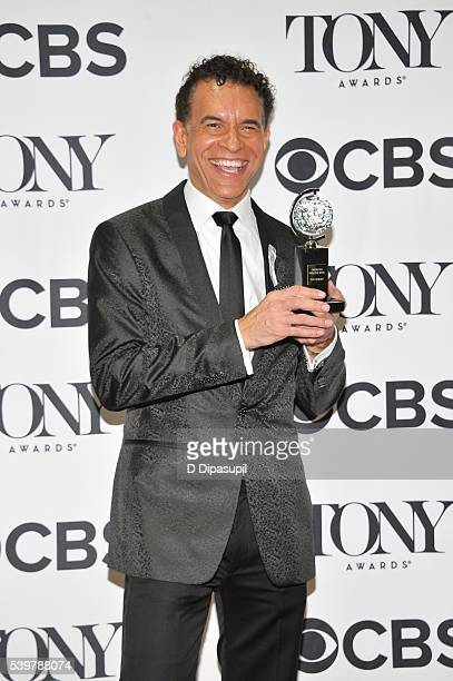 Brian Stokes Mitchell poses in the press room with his award at the 70th Annual Tony Awards at the Beacon Theatre on June 12 2016 in New York City
