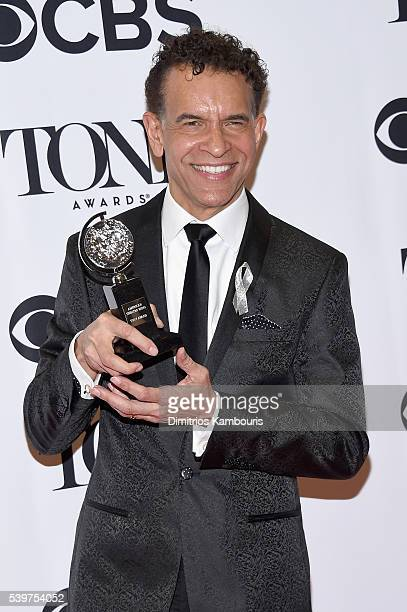 Brian Stokes Mitchell poses with the Isabelle Stevenson Award during the 70th Annual Tony Awards at The Beacon Theatre on June 12 2016 in New York...