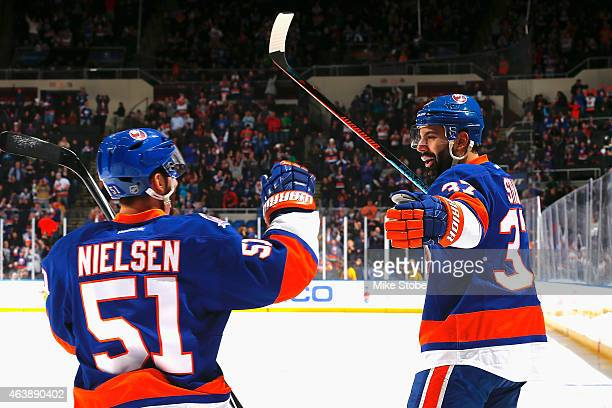 Brian Strait of the New York Islanders is congratulated by Frans Nielsen of the New York Islanders after scoring a first period goal against the...